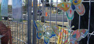 Photo of paper butterflies on a fence in Lac-Mégantic.