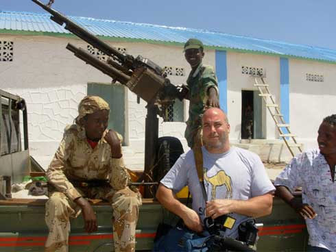 Jeff Stephen on assignment, pictured with child soldiers in Somalia courtesy of: Jeff Stephen