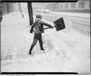 Boy shovelling