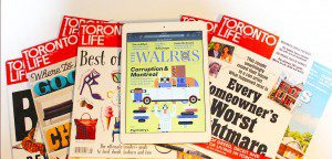 A pile of Toronto Life magazines with an iPad showing the cover of the Walrus.