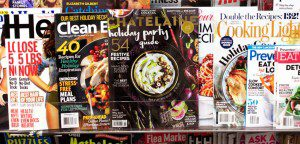 Chatelaine magazine appears on a newsstand alongside women's magazines