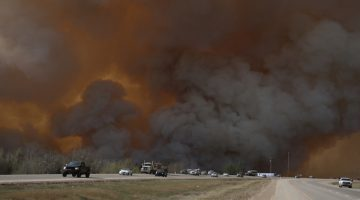 Many residents evacuated the city as Fort McMurray became embroiled with flames. (Courtesy Robert Murray/Fort McMurray Today)