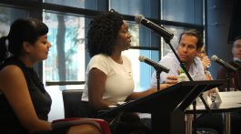 """Vicky Mochama addresses the audience at the Sept. 26, 2017 panel, """"Activist, advocate, columnist, reporter: Where's the line?"""" about how she incorporates being an activist into the journalism she does. (Dagmawit Dejene/RRJ)"""