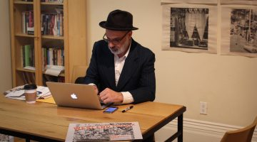 Dave Bidini, editor of the West End Phoenix works at his desk in the Gladstone Hotel.