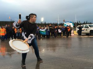 A woman drums during an anti-fracking protest.