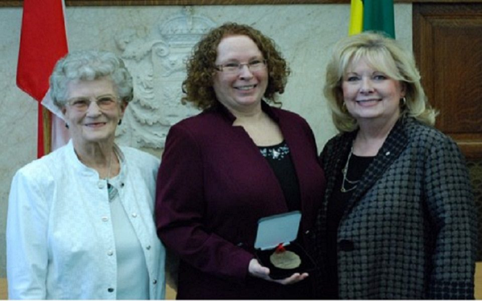 Alison Squires (middle) and co-recipient Marge Headington (left) receive the Senate 150 Medal from Senator Pamela Wallin (right). (Andy Labdon/Supplied)