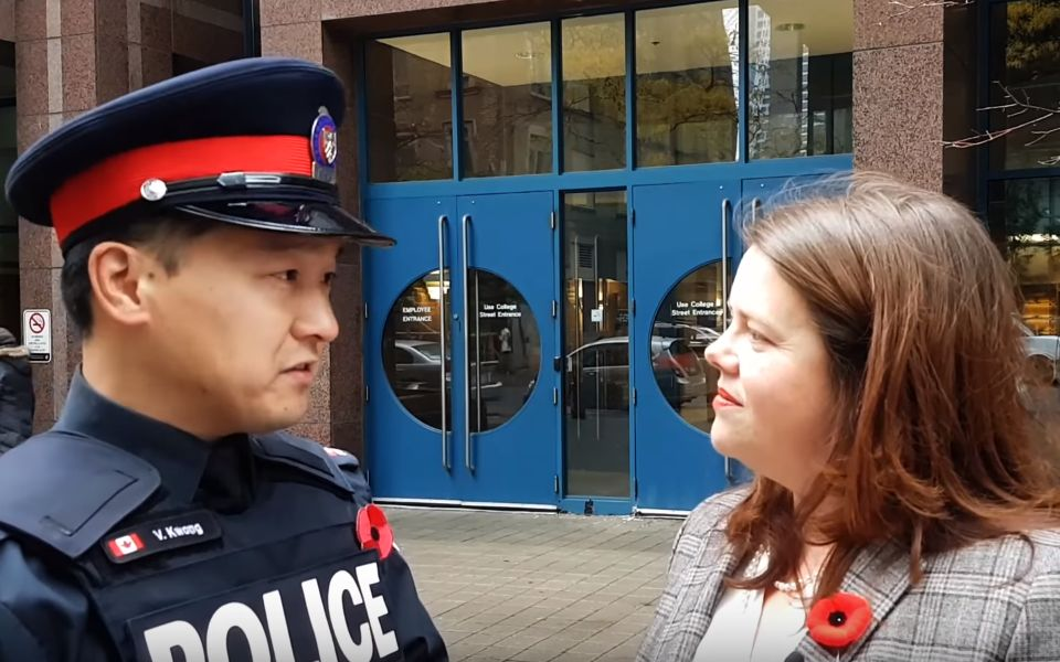 Toronto police Const. Victor Kwong, left, and spokeswoman Meaghan Gray in a Nov. 2, 2017 episode of TPS News. (Toronto Police Service/YouTube)