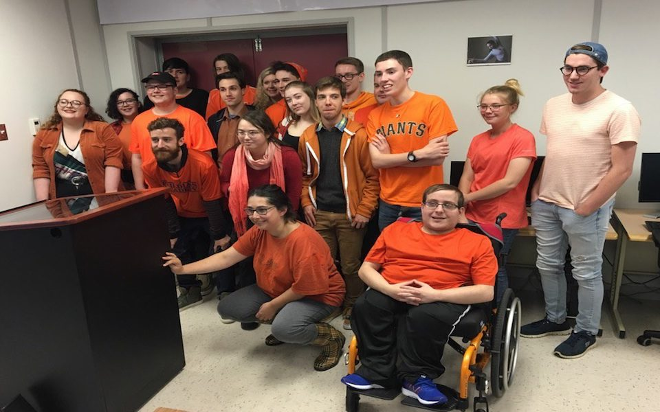 First-year journalism students at the College of the North Atlantic pose in themed gear for Orange Shirt Day, an annual event that recognizes the harm of residential schools in Canada.