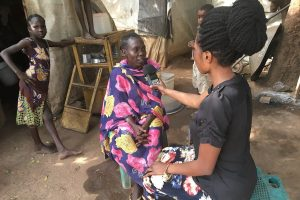 Photo: Laura Bain. JHR journalism trainee interviewing Internally Displaced Persons in Wau, South Sudan