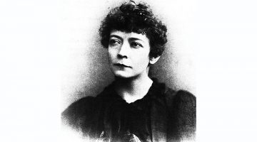 A black and white portrait of Kit Coleman