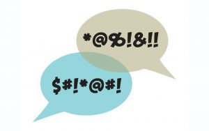 Two speech bubbles with symbols indicating swear words.