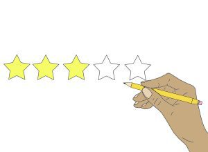 A hand fills in stars for a review