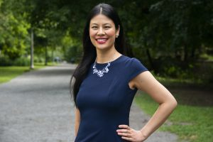 Journalist Karen K. Ho wearing a navy dress and necklace