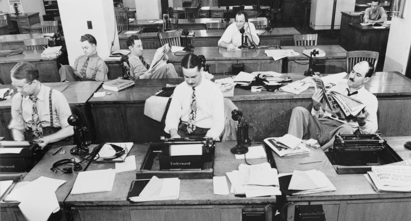 Reporters sit in the NY Times newsroom