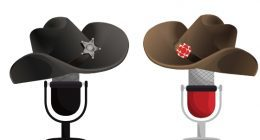 Two microphones wearing cowboy hats face each other. One microphone wears a black hat, the other wears a brown hat with a CBC logo on it.