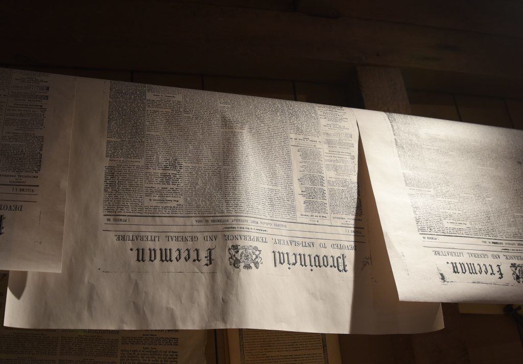 Copies of the Provincial Freeman hang to dry at Mackenzie House.